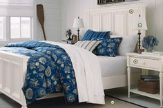 I love white painted wood furniture.  And this navy blue seashell comforter makes all the white pop.