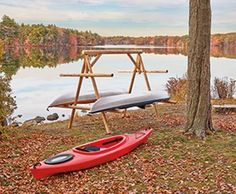 "Kayak Rack - Walpole Outdoors.  Handcrafted from peeled Northern White Cedar timbers for that authentic, rugged outdoors look. Holds four kayaks with room to house two paddle boards between the bottom kayaks. Easy to move and relocate. 7'L, 8' W, 78""H."