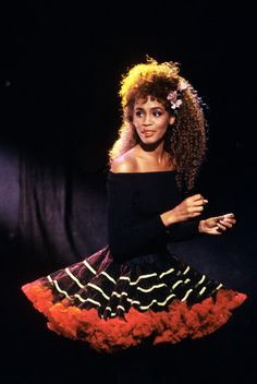 Whitney Houston. BIG poofy skirt. Black tights. Off the shoulder top. Lots of ribbons and bows. Colorful eyeshadow. Very pink blush.