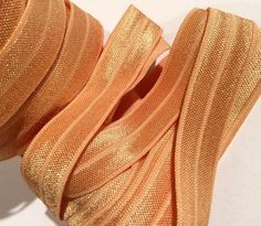 """Pale gold 5/8"""" fold over elastic FOE. For making baby headbands, barefoot baby sandals, sewing cloth diapers, lingerie & more."""
