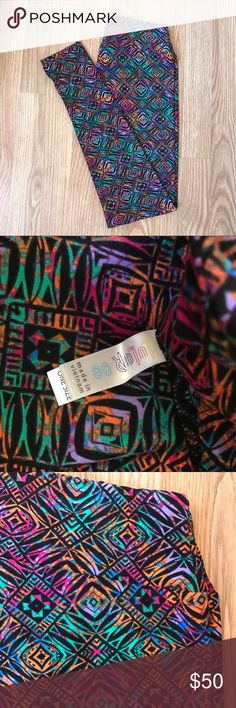 BNWT LuLaRoe Leggings OS Multicolored Tribal Black Brand New With Tags. Never worn. LuLaRoe Leggings with multicolored jewel toned tribal print on black background. Size OS (One Size fits 2-10). Comes from a smoke free home. I do bundle so check out my other listings and save when you buy more :)  #lularoe #lularoeleggings #lularoeos #leggings #tribalprint LuLaRoe Pants Leggings