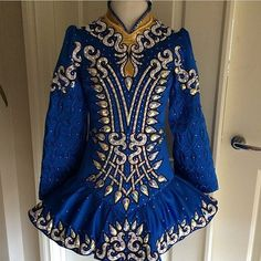 Irish Dance Solo Dress Costume by Sew Irish.  Looks a lot like a Celtic Star to me.  Encrusted dresses are catching.