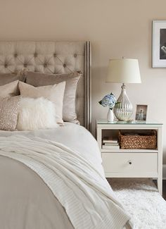 Shelf instead of drawer  Lampshade base  Glam mauve, pink & gray bedroom - Pale mauve walls paint color, gray linen tufted headboard with nailhead trim, pink & mauve pillows, pink metallic pillow, white, shag pillow, gray duvet, white wool, rug, silver, lamp and white nightstand.