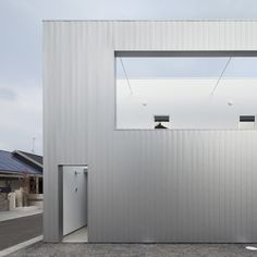 Metal-clad house in Japan by Eto Kenta conceals its garden