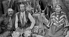 L-R: Unknown, Yellow Kidney (Pikuni Blackfeet) and his wife, Hairy Faced Woman (Pikuni Blackfeet) - circa 1940