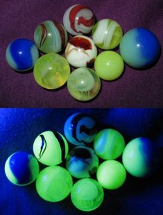 """I just discovered that i have a BUNCH of """"glowies."""". Whee!! Vaseline glass marbles (bottom - shown under black light)"""