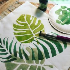 Fresh and summery stenciling on throw pillows with the help of our Hunter Green Metallic Paint! Project by Cathy Rinn of Kelly Belle Studios