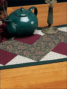 """Create an easy table runner that could be displayed any day of the year with this free quilted table runner pattern. Finished runner size is 13 1/4"""" x 47 3/4"""", pieced. Skill Level: Easy"""