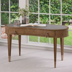 Fluid, elegant kidney shapes are the hallmark of the sophisticated Adelaide Collection. Made of figured eucalyptus with a soft gray finish, it features custom-designed antique nickel hardware and sabots. Inset leather tops.