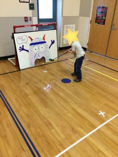 Monster Hockey shot or mini golf.  Use 1.5 inch thick foam board free from a teachers store.  Cut out the mouth with a jog saw.
