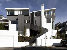 Utilising the existing concrete structure of a two-storeyed house, Parsonson Architects has designed two cleverly laid-out apartments that maximise the sun throughout the day and views of Wellington's harbour, city and bush-clad hills. 1950s House, Concrete Structure, Apartments, Architects, Layout, Homes, Urban, Mansions, House Styles