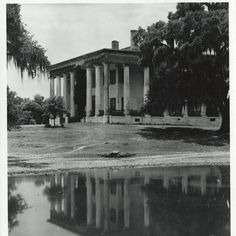 Greenwood Plantation, St. Francisville, Louisiana.  The house burned to the ground leaving only the columns.  Someone came had the columns straightened and rebuilt the house.  It is again a showplace.