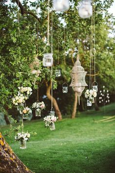hanging lanterns + vases + votives: