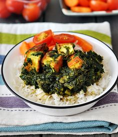 """I've made a chicken version of this curry some time ago and you probably don't come across this particular curry in the Indian restaurants often. Lamb and spinach curry, maybe. However, what's common is palak paneer which can be found under the vegetarian section on the menu. """"Geeze Emily, why the specification of the location …"""
