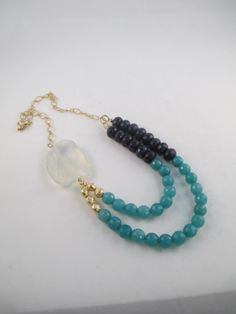 Opalite, green and blue candied jade with 14K rolled gold chain. A beautiful necklace for spring.