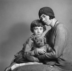 Christopher Robin with Winnie The Pooh and his mother.