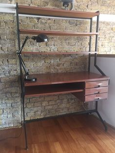 It has three functioning drawers but no key, three shelves over the desk, ideal for books and, a shelf under the desk. Very stylish desk, bought in Italy 5 years ago. Not sure who the designer is. Teak veneered and generally in good condition, one or two minor cracks around the edges. | eBay!