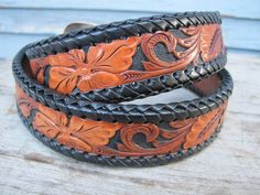 black and brown hand tooled leather belt