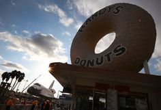 The #Endeavour parked in front of Randy's Donuts in L.A. Credit: Brian Van Der Brug / Los Angeles Times