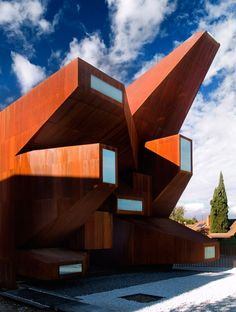 """Pre-rusted steel church by Vicens + Ramos features an """"explosion"""" of windows."""