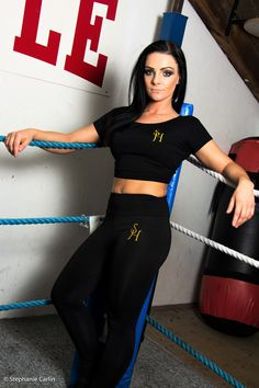 Model wears Black S.H crop with Black embroidered exercise leggings.