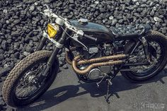 1975 Honda CB250, check out the cool triangular headlamp, I also love the chesterfield seat style. http://thebikeshed.cc/2013/08/29/oems-vulcan/
