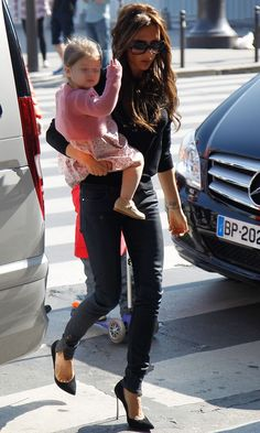 Victoria Beckham and Harper Beckham out in Paris