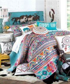 """Teen Cowgirl Bedding Teen Cowgirl Bedding: The new """"Ride and Have Fun"""" quilt and coordinating bedding is cheerful and colorful, with a pretty Southwestern arts & crafts look that will brighten up any bedroom like a breath of fresh air. The cotton-rich ivory-colored quilt is decorated with stripes, floral patterns, and running horses in ocean blue,"""