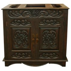 Elegant vanity design based on Spanish Colonial influences using the best quality Pinero wood. This great vanity is equipped, beneath its customizable counter top, with two cabinet doors with hand forged iron handles which open access to its practical inside. Inset top friezes around all sides are embellished through hand carved foliate colonial designs, as also occurs widely on the cabinet doors. After straight low moulding, occur bowed shaped reeded apron between bracket supports. This…