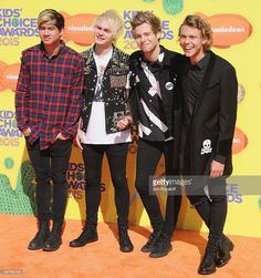 Musicians Calum Hood, Michael Clifford, Luke Hemmings, and Ashton Irwin of 5 Seconds of Summer arrive at Nickelodeon's 28th Annual Kids' Choice Awards at The Forum on March 28, 2015 in Inglewood, California.