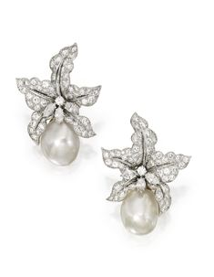 Natural baroque pearls, diamonds, and platinum ear clips