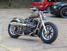 Hinckley Triumph bare metal hardtail custom with Road King wheels and 2-into-1 exhaust by Acme Choppers