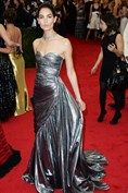 Lily Aldridge wore a metallic Michael Kors gown and carried a clutch by Salvatore Ferragamo