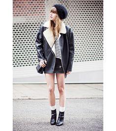 @Who What Wear - Lisa Dengler of Just Another Fashion Blog  On Dengler: Zara beanie; ASOS Cocoon Bonded Borg Biker Coat ($110); Cos top; Zara skirt; Coach Mini Borough Bag ($378); Zara boots.