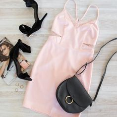 Pink and Lace?! What more could a girl want in a date night dress? The cut outs on the sides of this spring dress complete the whole outfit. The black shoes are a nice touch too!