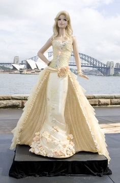 "To celebrate Barbie's 50th birthday, in Sydney, Australia, Mattel unveiled a nearly seven-foot tall ""Barbie doll"" chocolate mud cake. The 2,645 lb cake was covered in gold icing, gold silk, and 2,000 Swarovski crystals valued at $50,000, and was based on the design for the limited edition 50th Anniversary Barbie Doll."