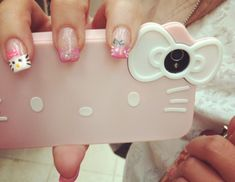 look at her nails too, Hello Kitty phone case