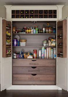 Photo by BMLMedia - Gorgeous Chef's pantry with large shelves, wine storage and large pull-out drawers.