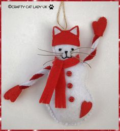 Snow-Cat  This little snow cat has been made from red and white felt and is filled with polyfill filling. The arms are pipe cleaners which can be