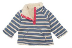 This organic cotton Snuggle Fleece will keep the chill out and the cuddles coming. It's reversible and ultra-cosy with on side being Frugi's organic cotton snuggly fleece fabric and the other designed with a nautical blue stripe. The popper fastening at the neck makes it easy to pull on and off, but best of all, it's machine washable. Perfect! Made with Organic Cotton. Perfect for little walks along the seafront and autumn adventures.