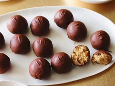 Peanut Butter Cookie Dough Rich, eggless peanut butter cookie dough is even better when it's rolled into truffles and robed in chocolate. Try using coconut oil in the coating — peanut butter, chocolate and coconut are a winning flavor trio. Peanut Butter Dessert Recipes, Peanut Butter Truffles, Cookie Dough Truffles, Best Peanut Butter, Chocolate Chip Cookie Dough, Peanut Cookies, Candy Cookies, Eating Raw Cookie Dough, Truffle Recipe