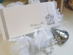 Birdcage themed wedding invitation with silver ribbon.  Personalised wedding stationery in the UK