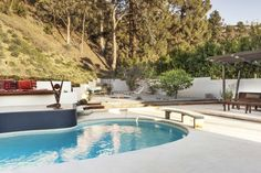 Midcentury renovation in Brentwood with pool, fire pit, and pergola
