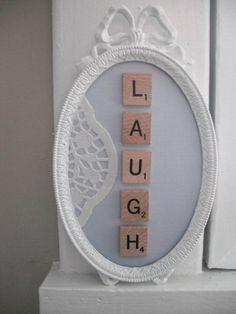 Scrabble tile laugh.