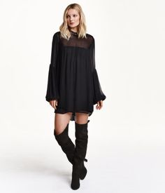 Short, wide-cut dress in chiffon with a low lace collar and buttons at back of neck. Long balloon sleeves, hem-stitch embroidery at shoulders, and a rounded hem. Slightly longer at back. Half-lined.