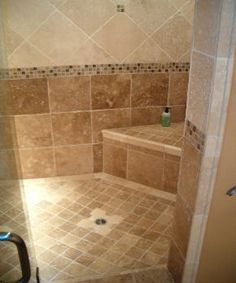 "Love this!  Mosaic tile floor and ceiling.  12x12's (or 13's) on the wall with a 3 row 1""x1"" mosaic border followed by 12 x 12's on point.  This website also gives instructions for building your own tiled shower stall."