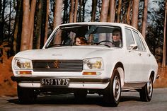 Peugeot 504 - The most comfortable car I have ever owned or driven. My registration was NIM 504