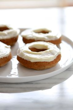 Eggless Carrot Cake Doughnuts with Cream Cheese Frosting...because I'm pregnant and keep forgetting to buy eggs! From www.laurenslatest.com