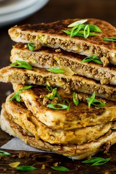 Murtabak is crispy, flaky, chewy roti stuffed with soft warm spiced ground beef and egg filling.