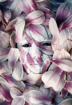 Flower Girl - a woman that is painted up to look like flowers, so we call her the flower girl.
